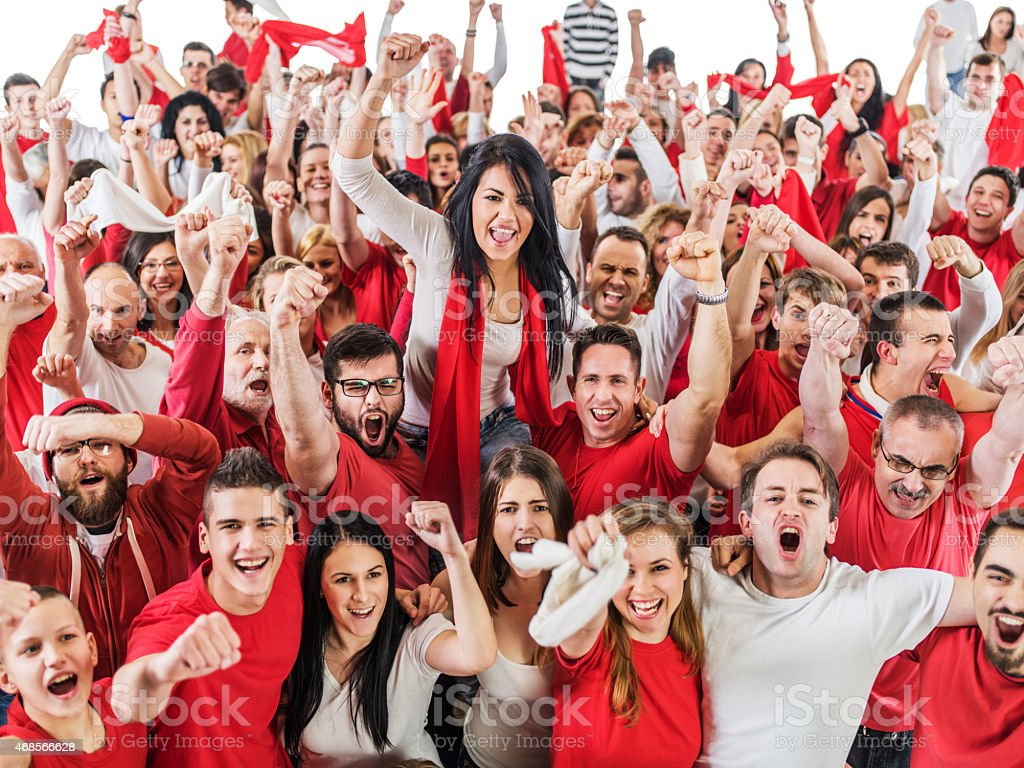 Large group of sport fans cheering. Isolated on white. stock photo