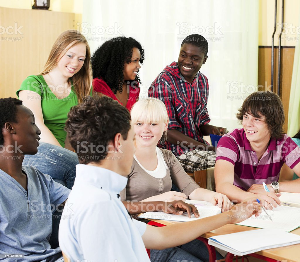 Large group of students studying together in the classroom. royalty-free stock photo
