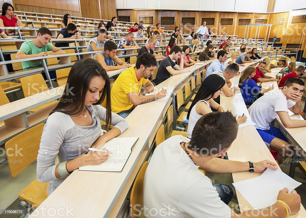 Large group of students writing. royalty-free stock photo