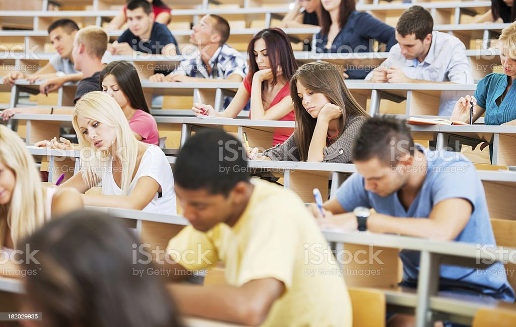 Large group of students writing stock photo