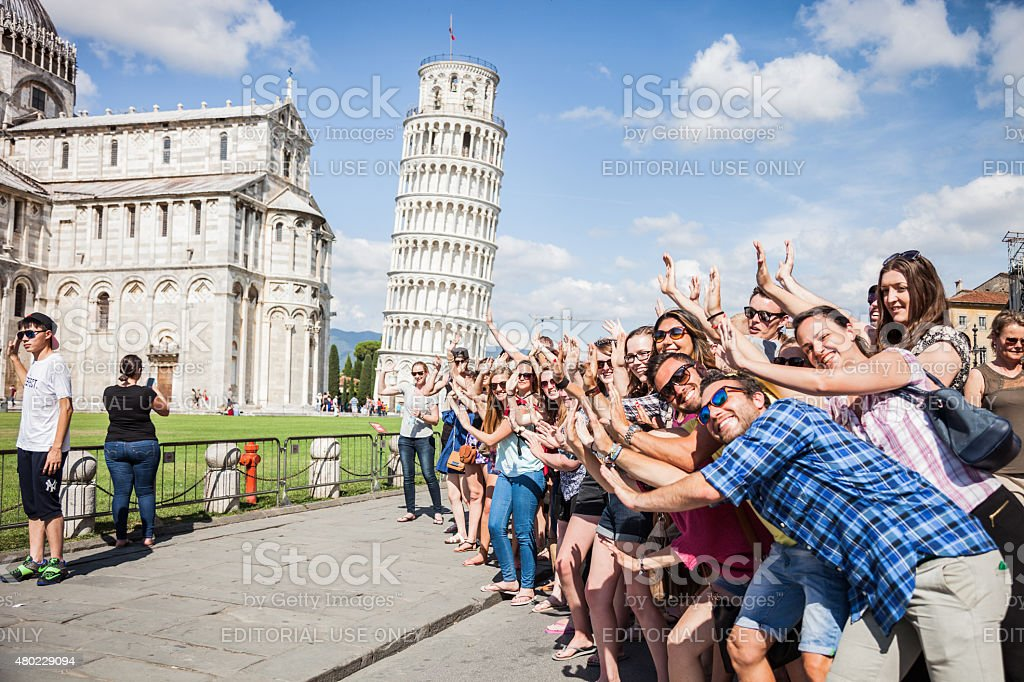 Large group of tourist having fun in Pisa stock photo