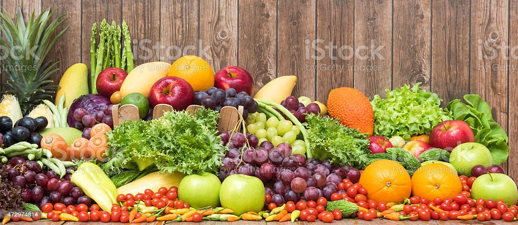 Large group of tropical fruits and vegetables organics stock photo