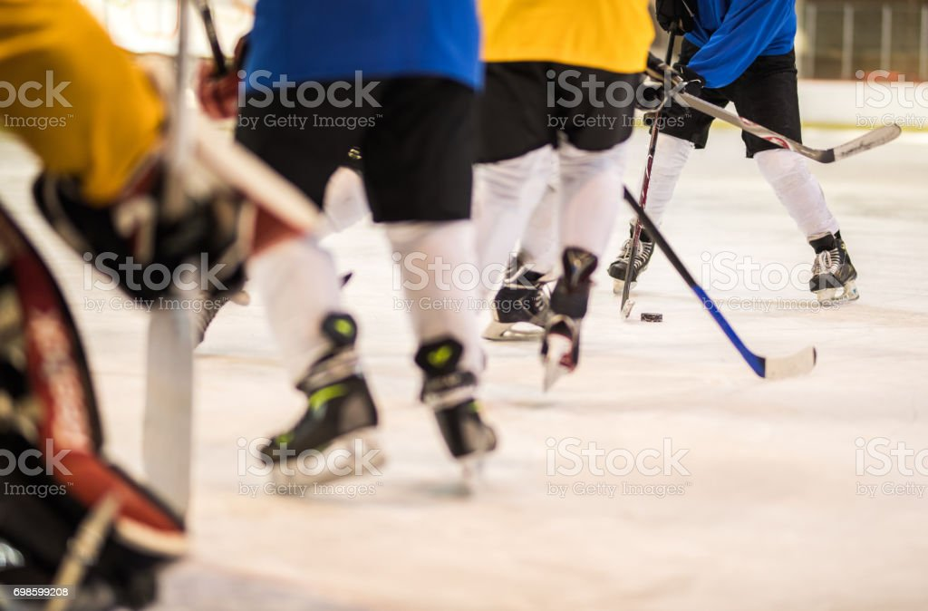 Large group of unrecognizable ice hockey players in action on a match. stock photo