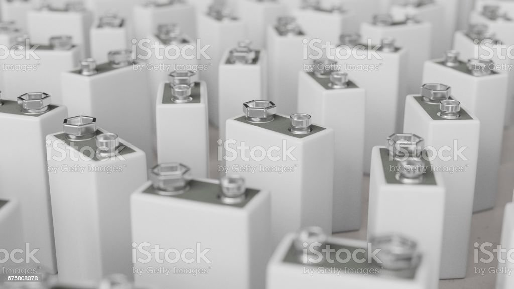 Large Group of Variously Rotated Blank White 9volt Batteries stock photo