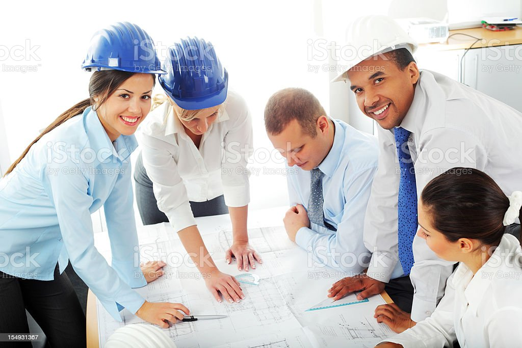 Large group of young architects are working together. royalty-free stock photo