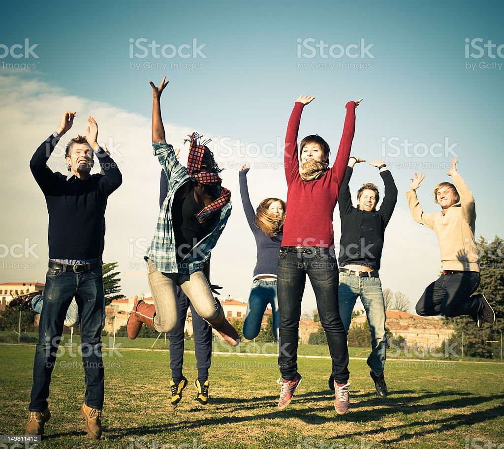 Large group of young jumping people having fun royalty-free stock photo