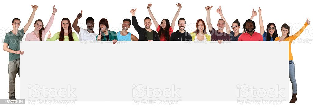 Large group of young multi ethnic people holding empty banner stock photo