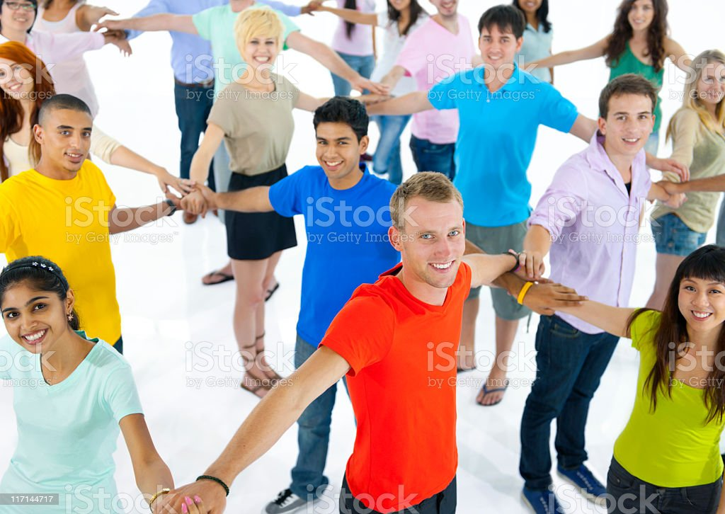 Large group of young multi-ethnic people connecting with each other royalty-free stock photo