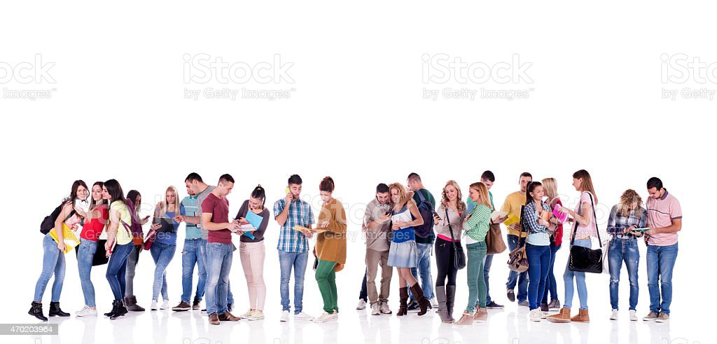 Large group of young multi-tasking students isolated on white. stock photo
