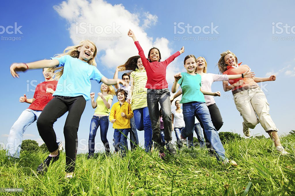 Large group running in the field. royalty-free stock photo