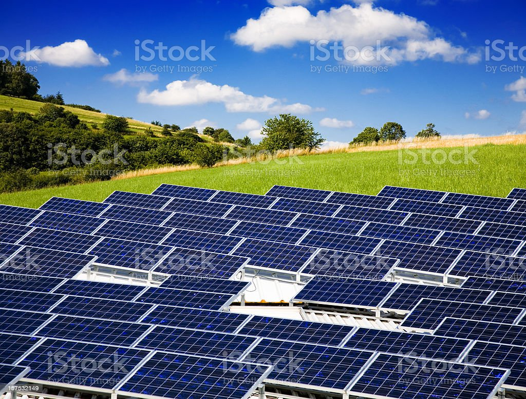 Large grouping of solar panels in a rural setting stock photo