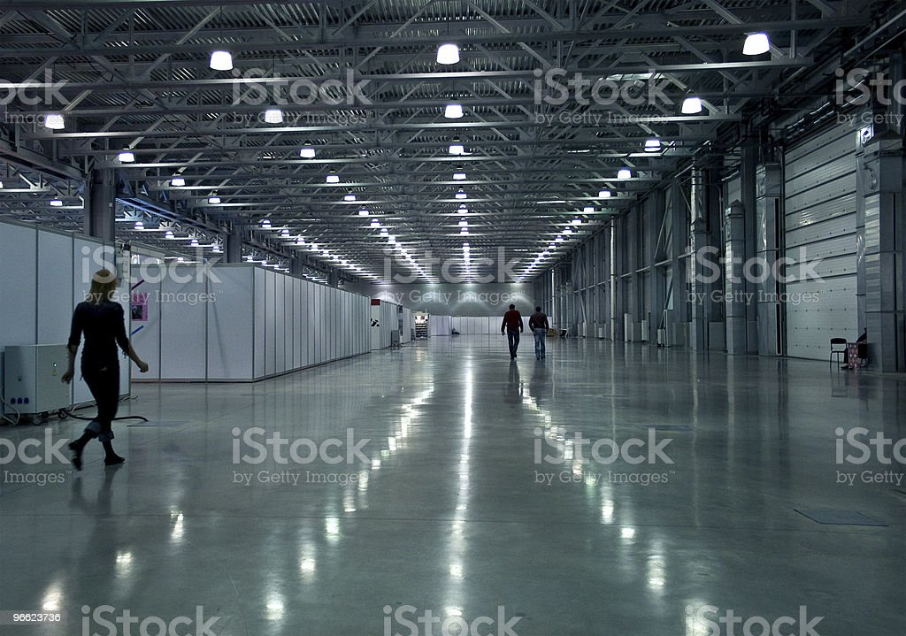 Large hall with people silhouettes, modern architecture. stock photo