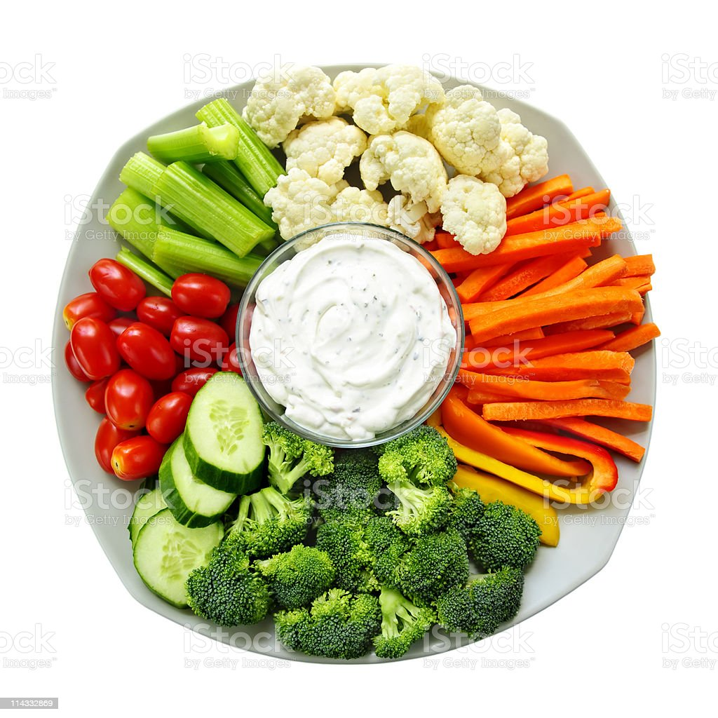 A large healthy plate of dip and vegetables stock photo