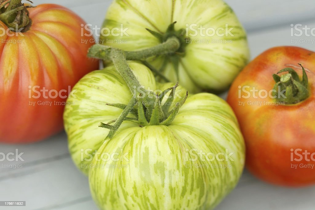 Large heirloom tomatoes on wood table royalty-free stock photo