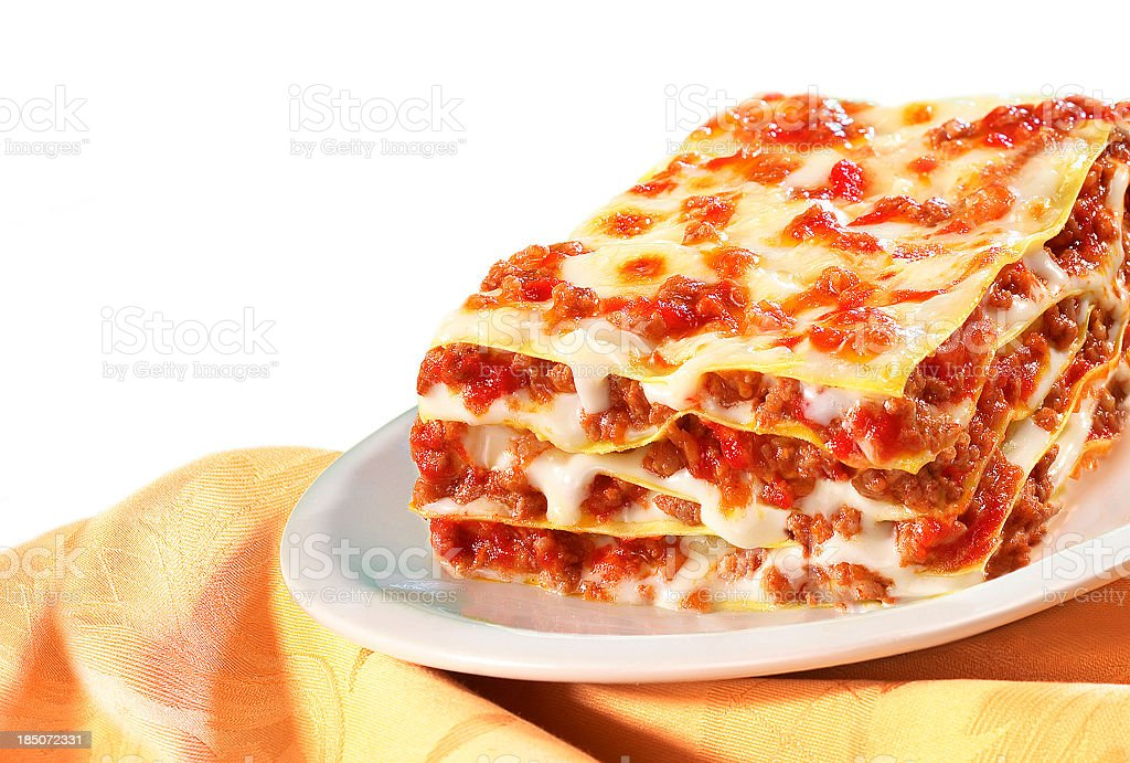 Large helping of lasagna on a white plate stock photo