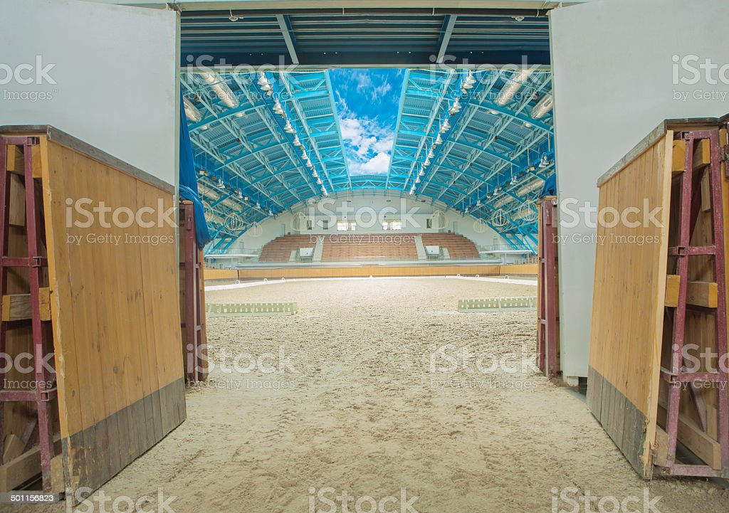 Large horse arena interior with open sky stock photo