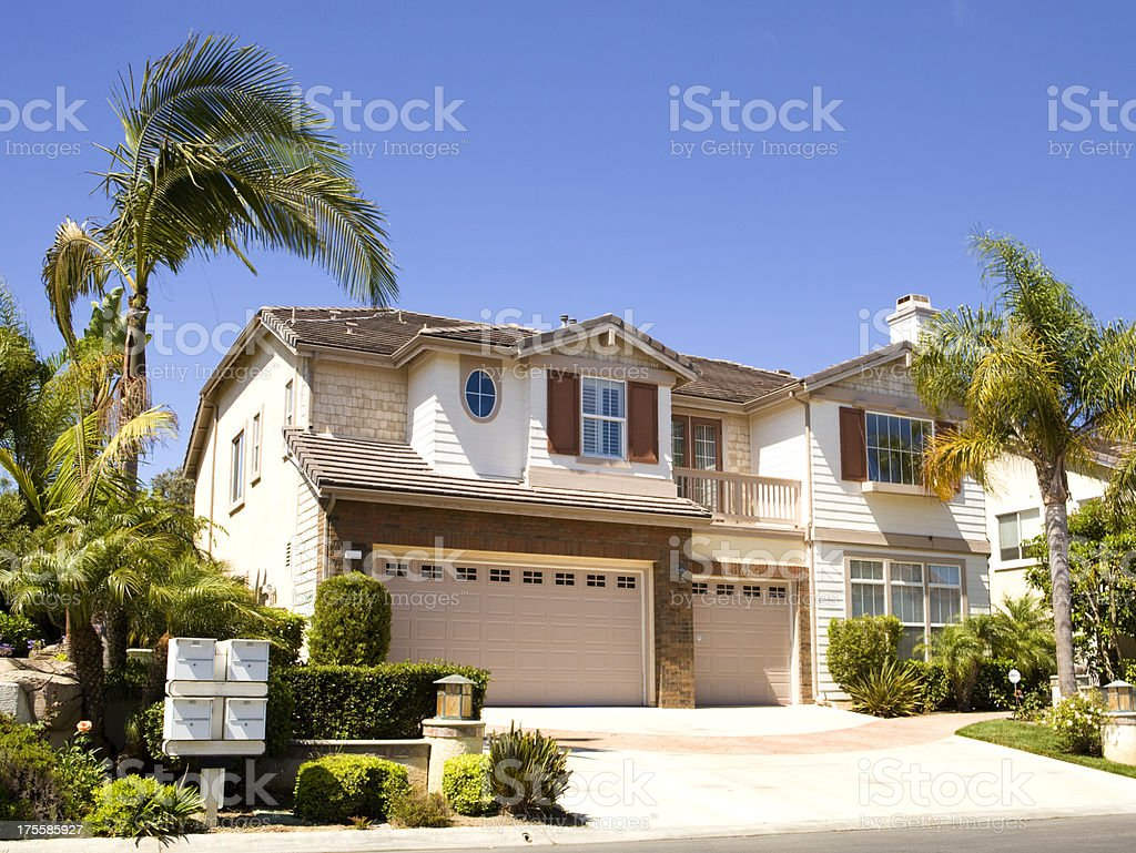 Large house next to palm trees in California stock photo