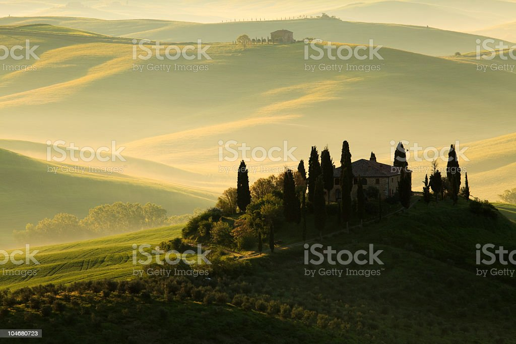 Large house overlooking green hills in Tuscany stock photo