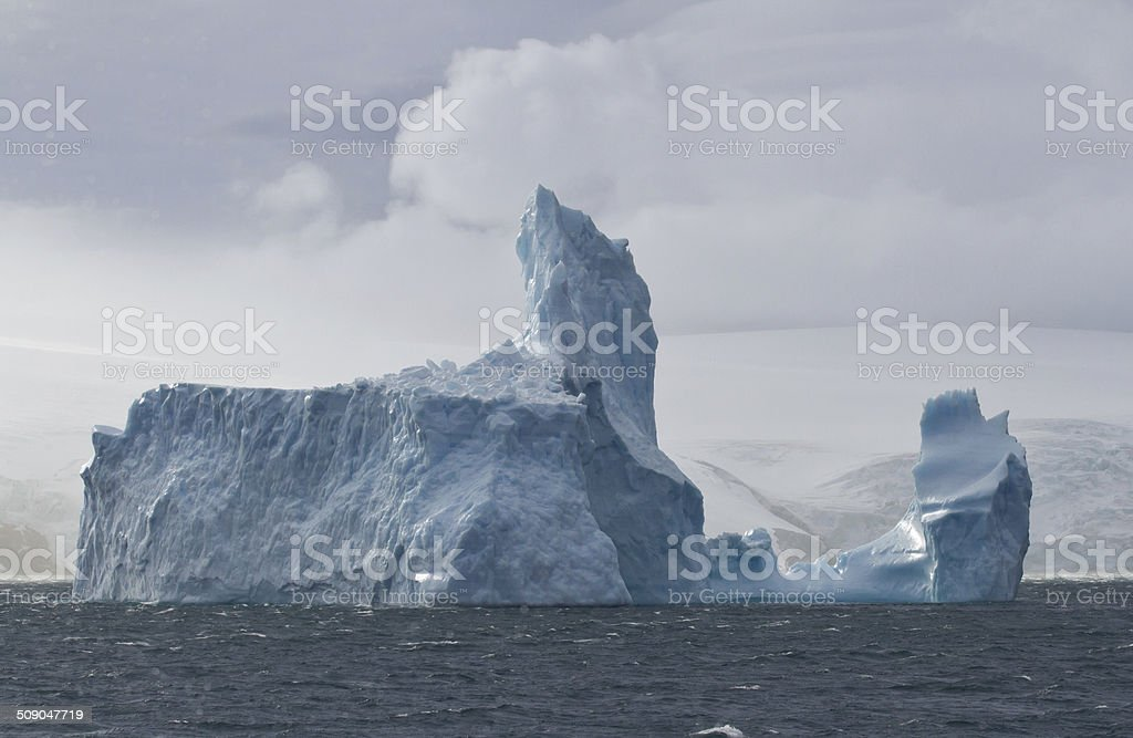 large iceberg in the ocean off the coast stock photo