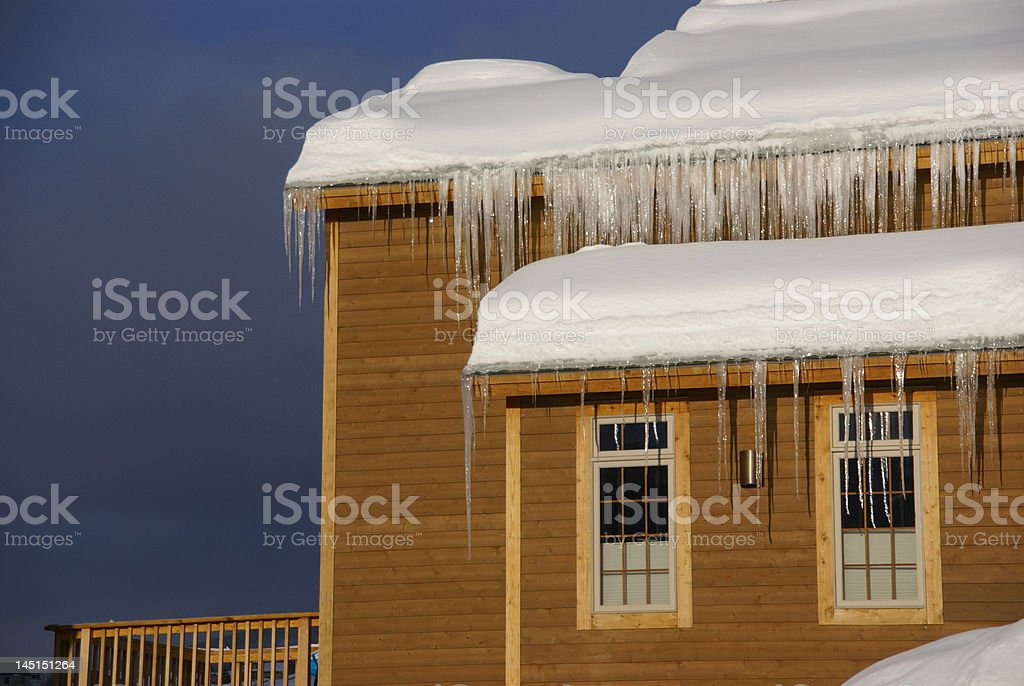 Large icicles on Townhouses after heavy snowstorm stock photo
