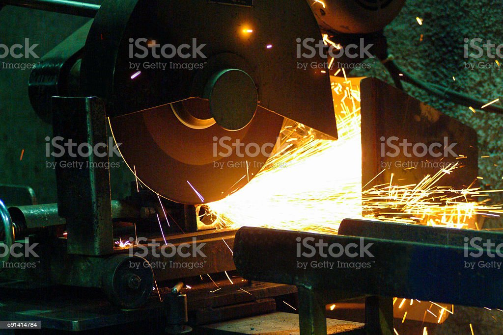 Large Industrial Circular Saw Operating in an Underground Shaft Mine stock photo