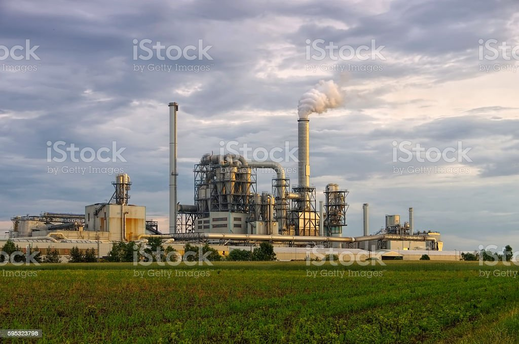 large industrial plant and smokestack stock photo