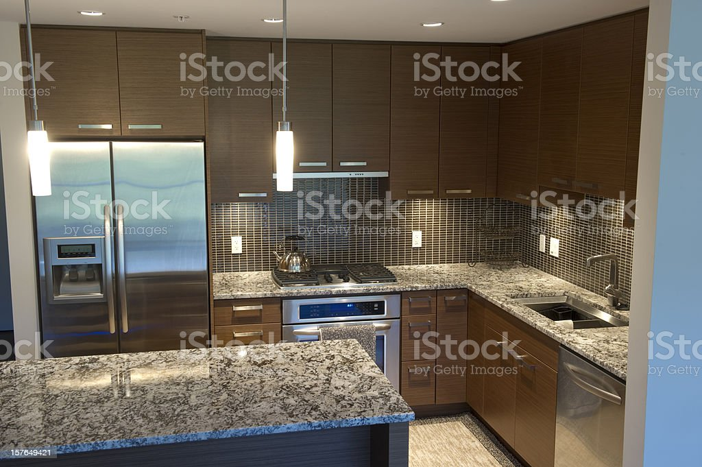 Large kitchen with Island with granite countertops royalty-free stock photo
