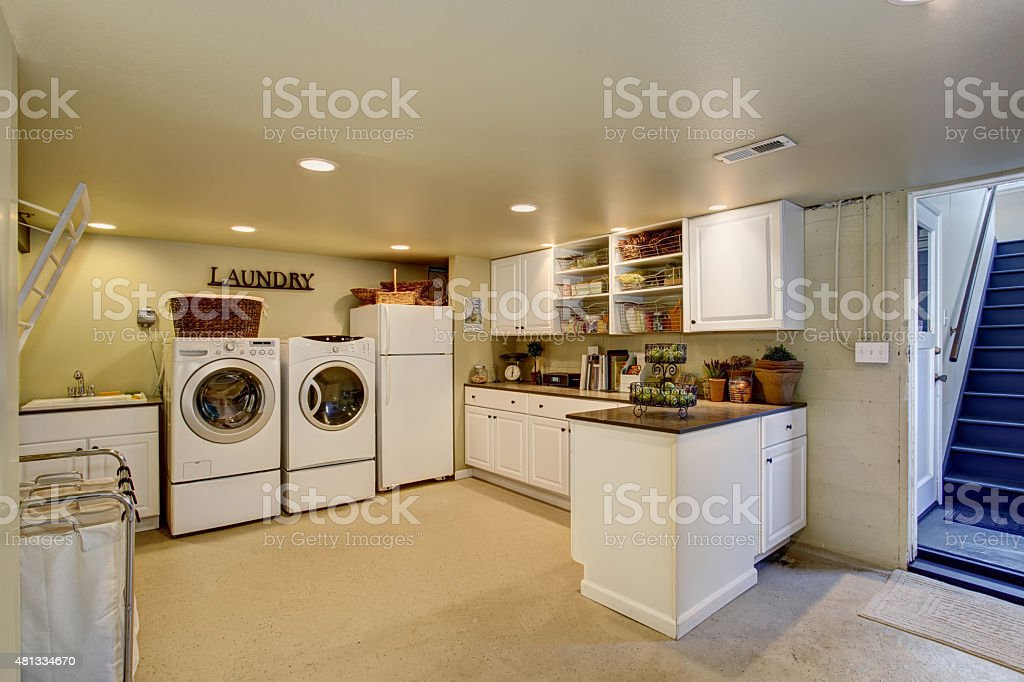 Large laundry room with appliances and cabinets. stock photo
