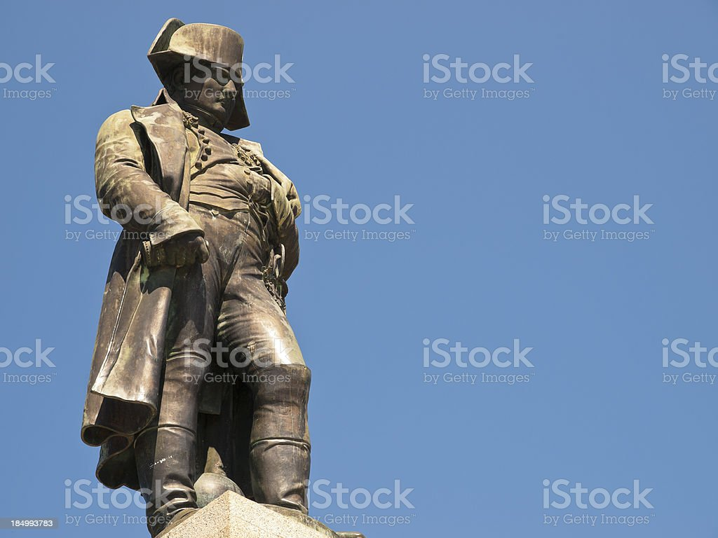 A large lifelike statue of Napoleon in Ajaccio by blue sky. stock photo