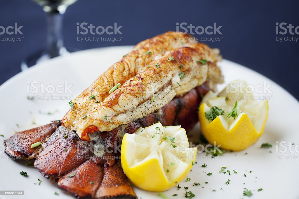 Large lobster tail served with white wine stock photo