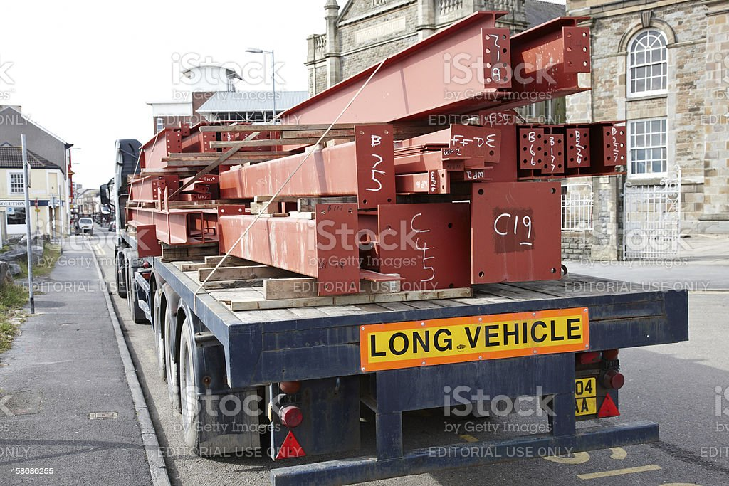Large lorry with heavy steel girders royalty-free stock photo