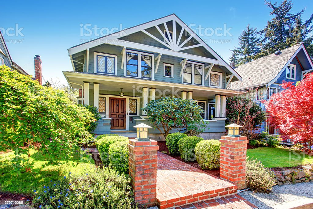 Large luxury blue craftsman classic American house exterior. stock photo