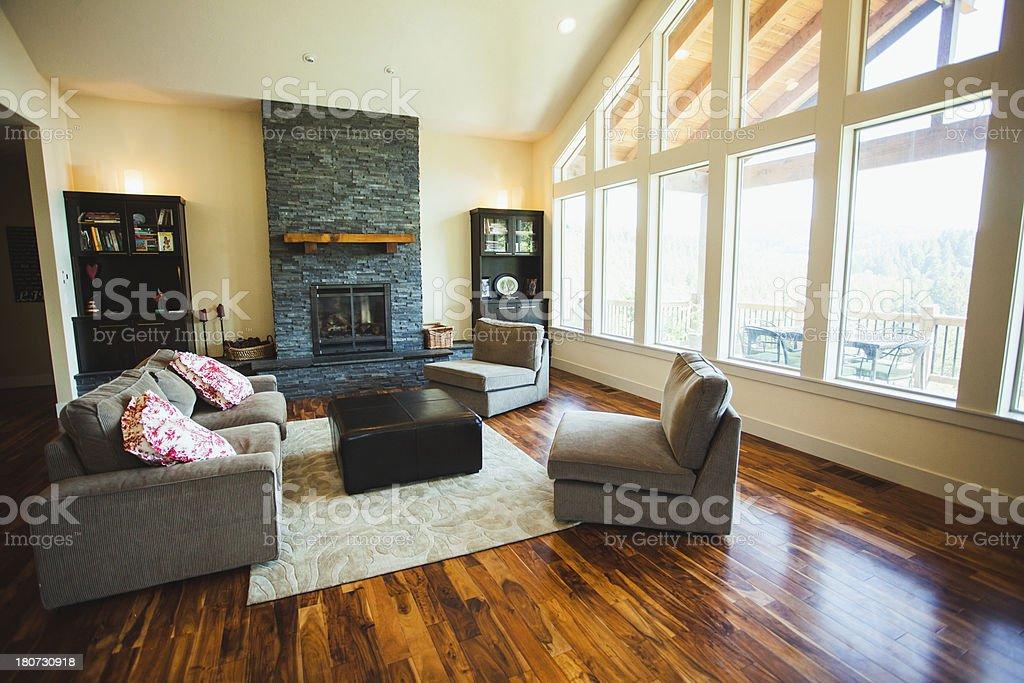 Large Luxury Home with Hardwood Floors Furniture and Big Windows royalty-free stock photo