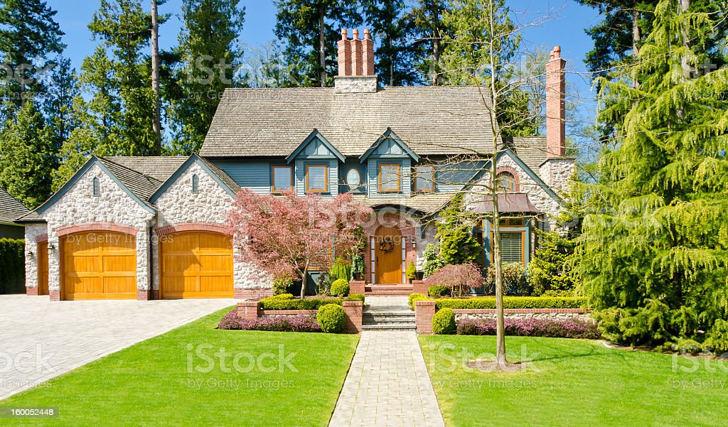 A large luxury house and a garden stock photo