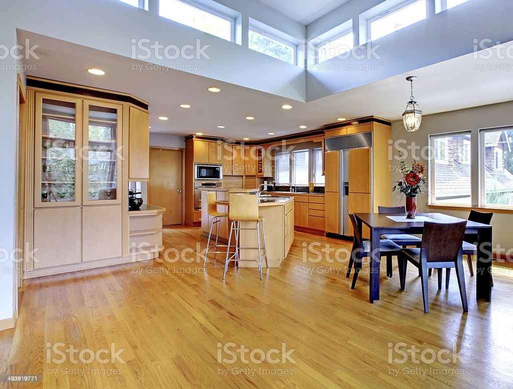 Large luxury modern wood kitchen with granite counter tops. stock photo