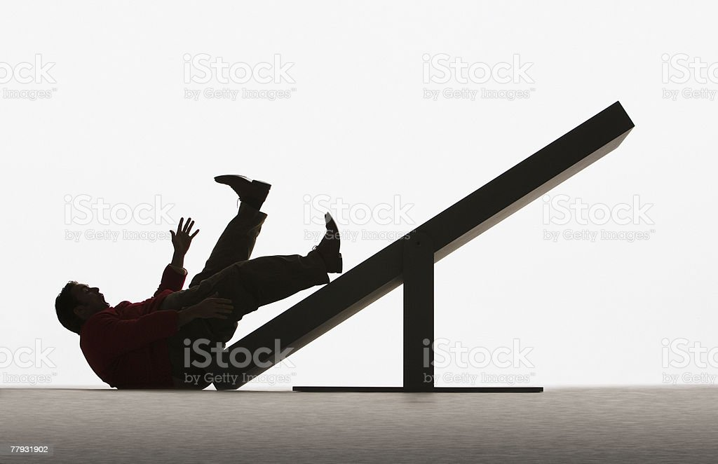 Large man falling off end of plank royalty-free stock photo