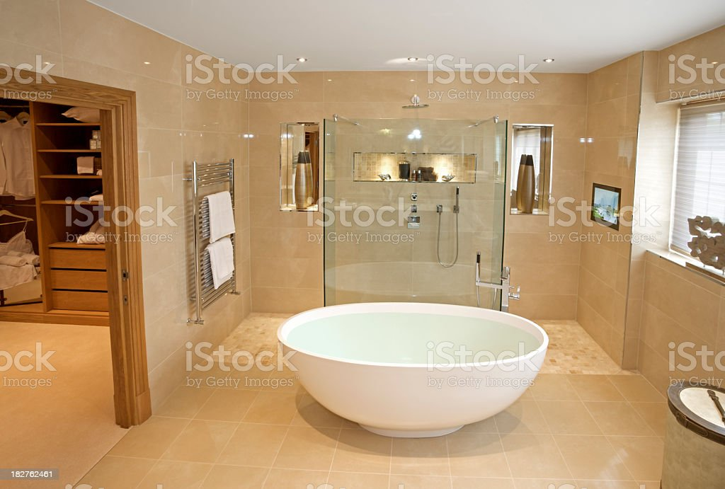 Large marbled tiled bathroom with oval tub and glass shower royalty-free stock photo