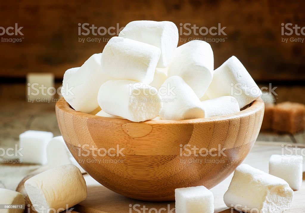 Large marshmallows in a wooden bowl stock photo