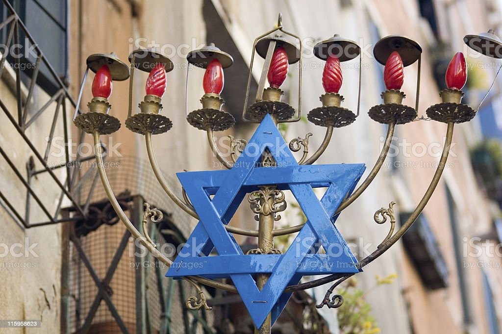 large menorah with blue Star of David royalty-free stock photo