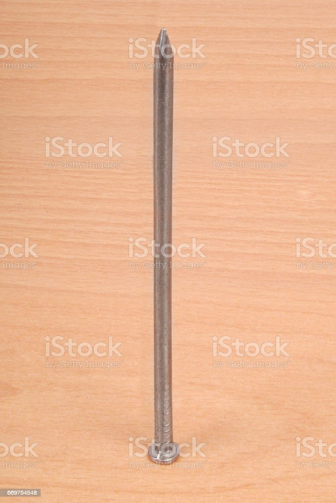 Large metal nail stock photo
