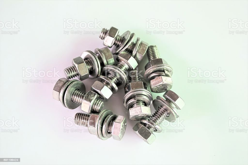 Large metal screw on a white background stock photo