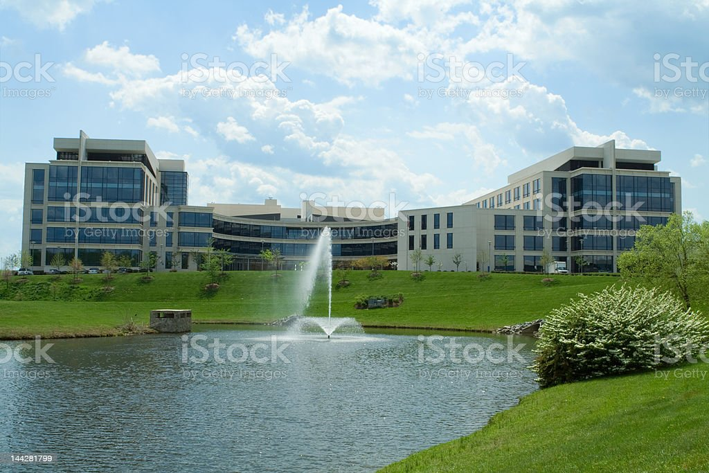 Large Modern Office Building Pond Fountain Grass Suburban Maryland, USA stock photo
