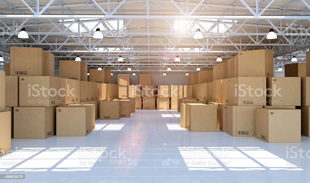Large modern warehouse full of mechandise and cardboard boxes stock photo