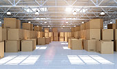 Large modern warehouse full of mechandise and cardboard boxes
