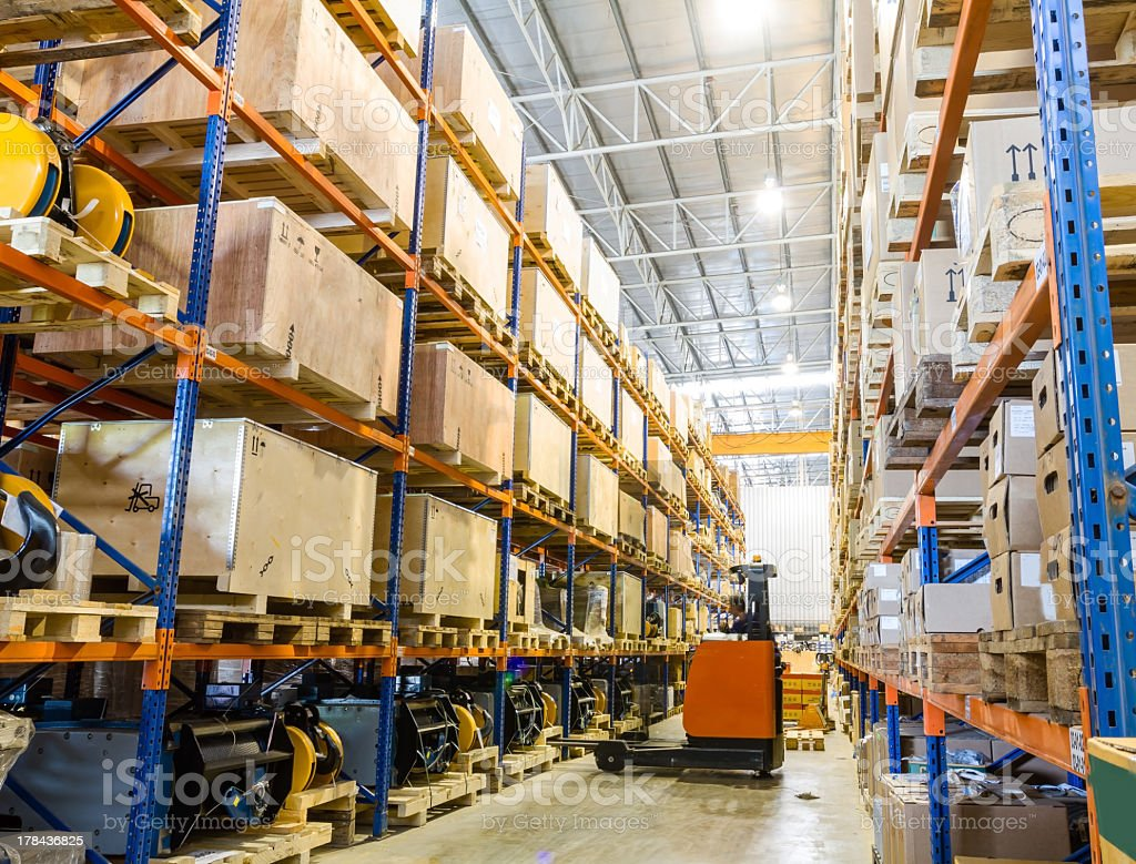 Large modern warehouse with forklifts stock photo
