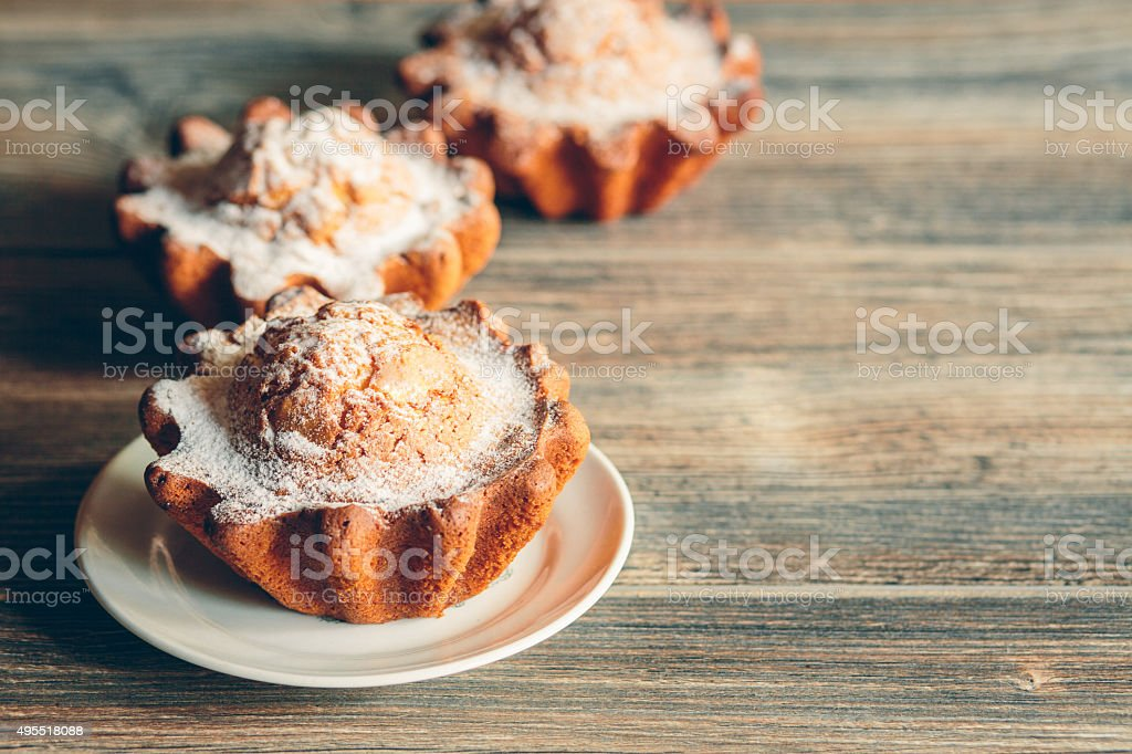 Large muffins on the table. Toned. stock photo