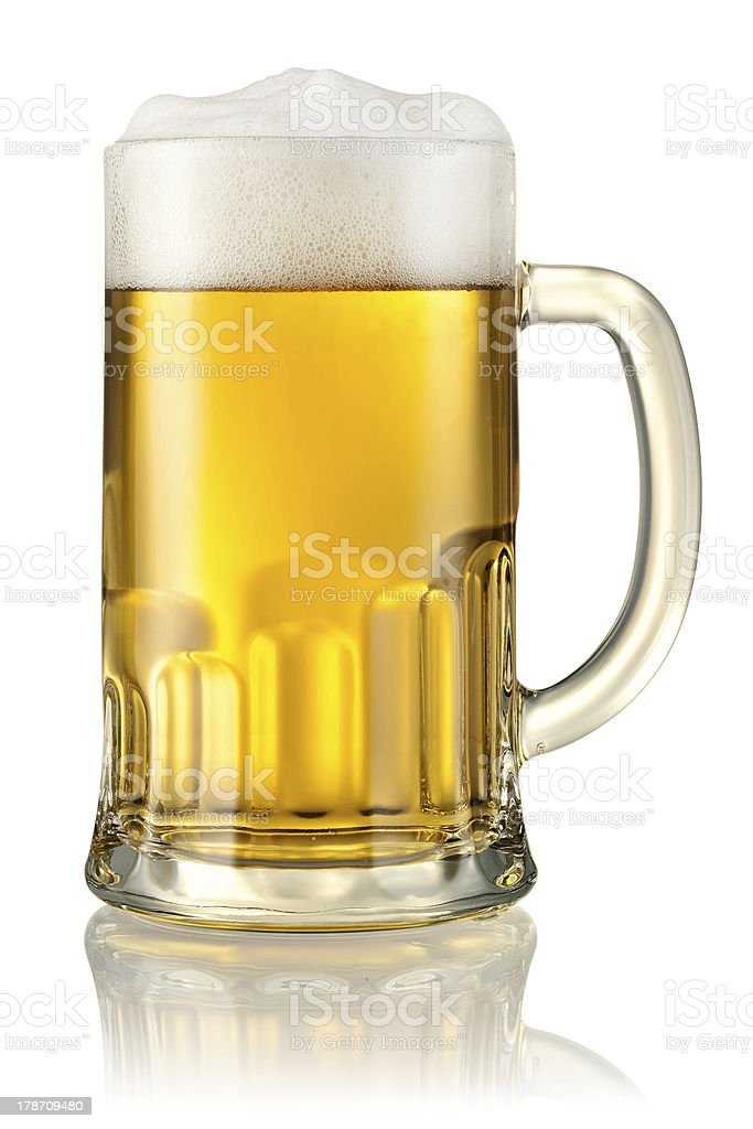 Large mug of just drawn beer on white table stock photo
