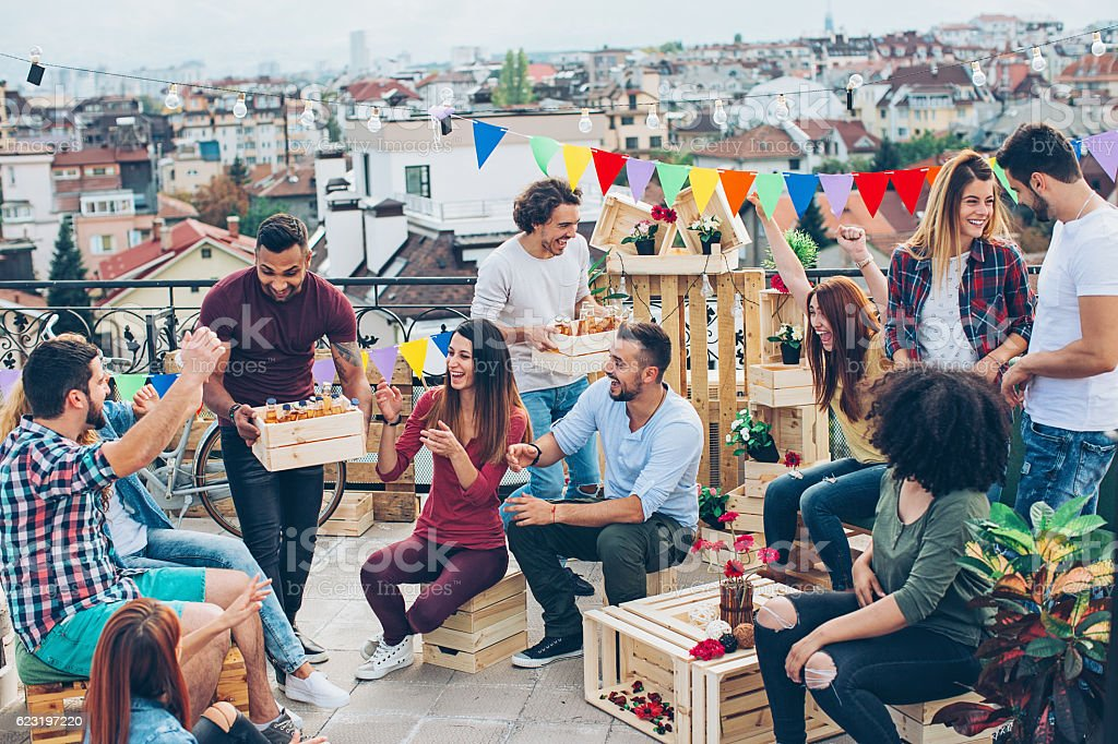 Large multi-ethnic group on a rooftop party stock photo