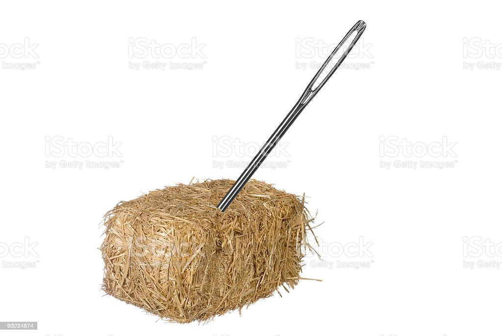 A large needle inside of a small haystack stock photo