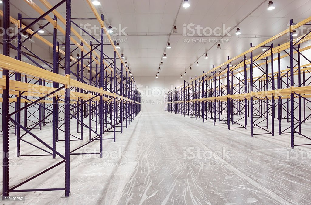 Large newly built warehouse with steel shelves